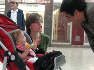 Mary-Lou Babineau, Green Party Candidate for Fredericton, with her daughter and a constiuent.